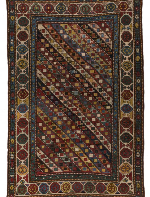 "Genje rug, late 19th century, 4'1"" x 6'2"", diagonal stripe design in field, collection of Larry Gerber"