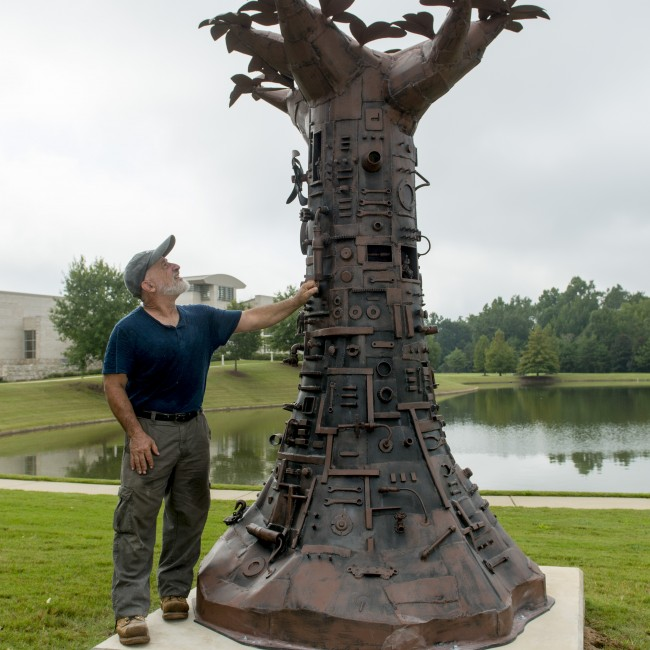 Artist Charles Pilkey shown here with Tree of Good and Evil.