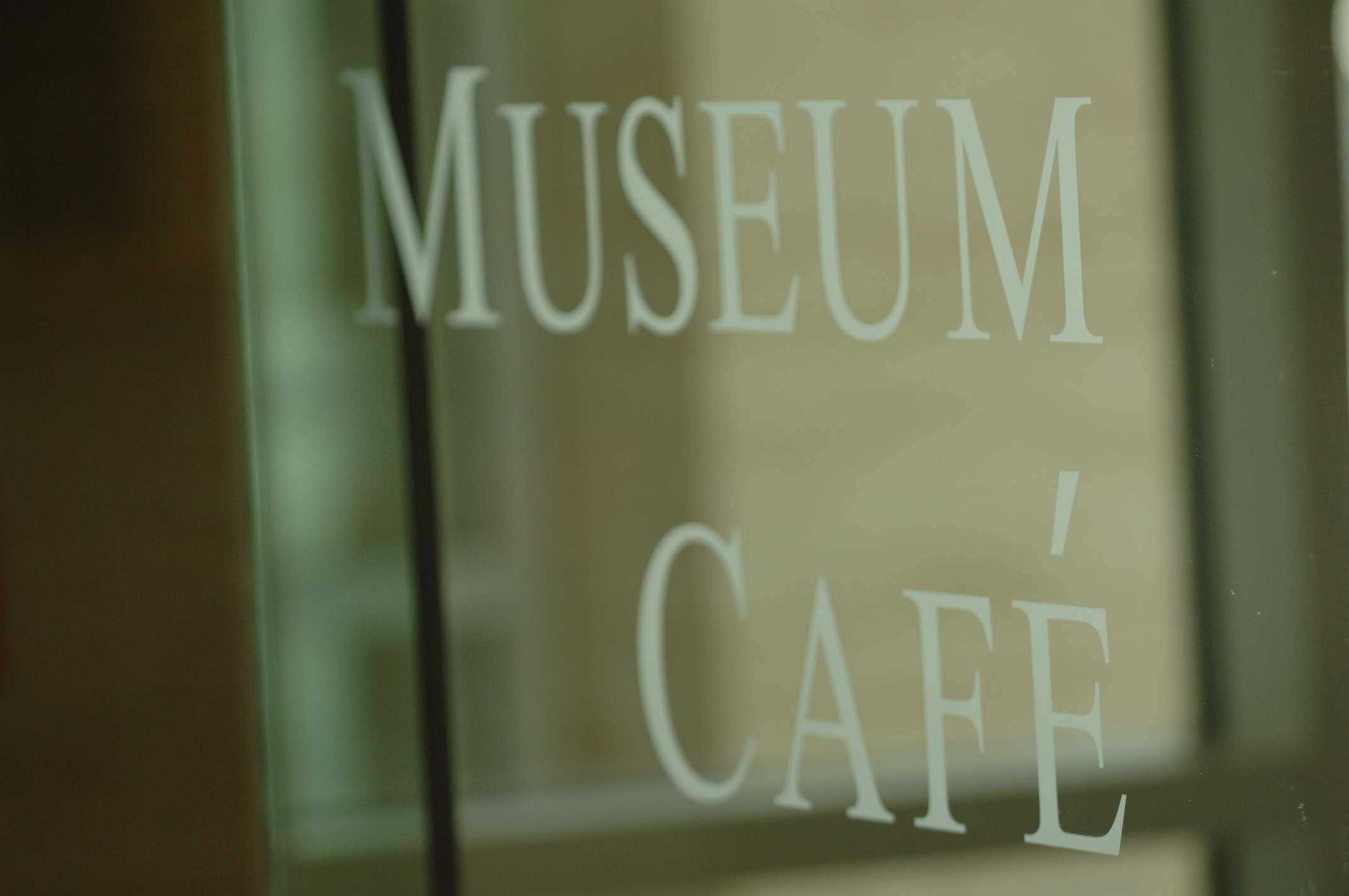Glass door of museum cafe