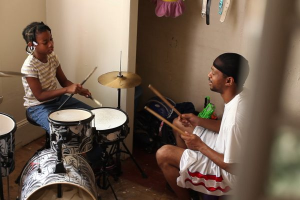 "Patricia ""PJ"" Rainey, Christopher ""Quest"" Rainey play drums. credit: Jonathan Olshefski"