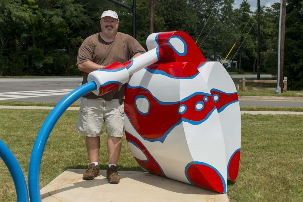 Adam Walls of North Carolina poses with his work Ker-Plunk