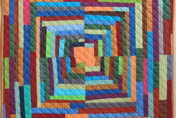 A multi-colored quilt by Cathy Fussell
