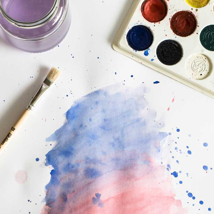 A wash of blue and red with a palet of watercolors