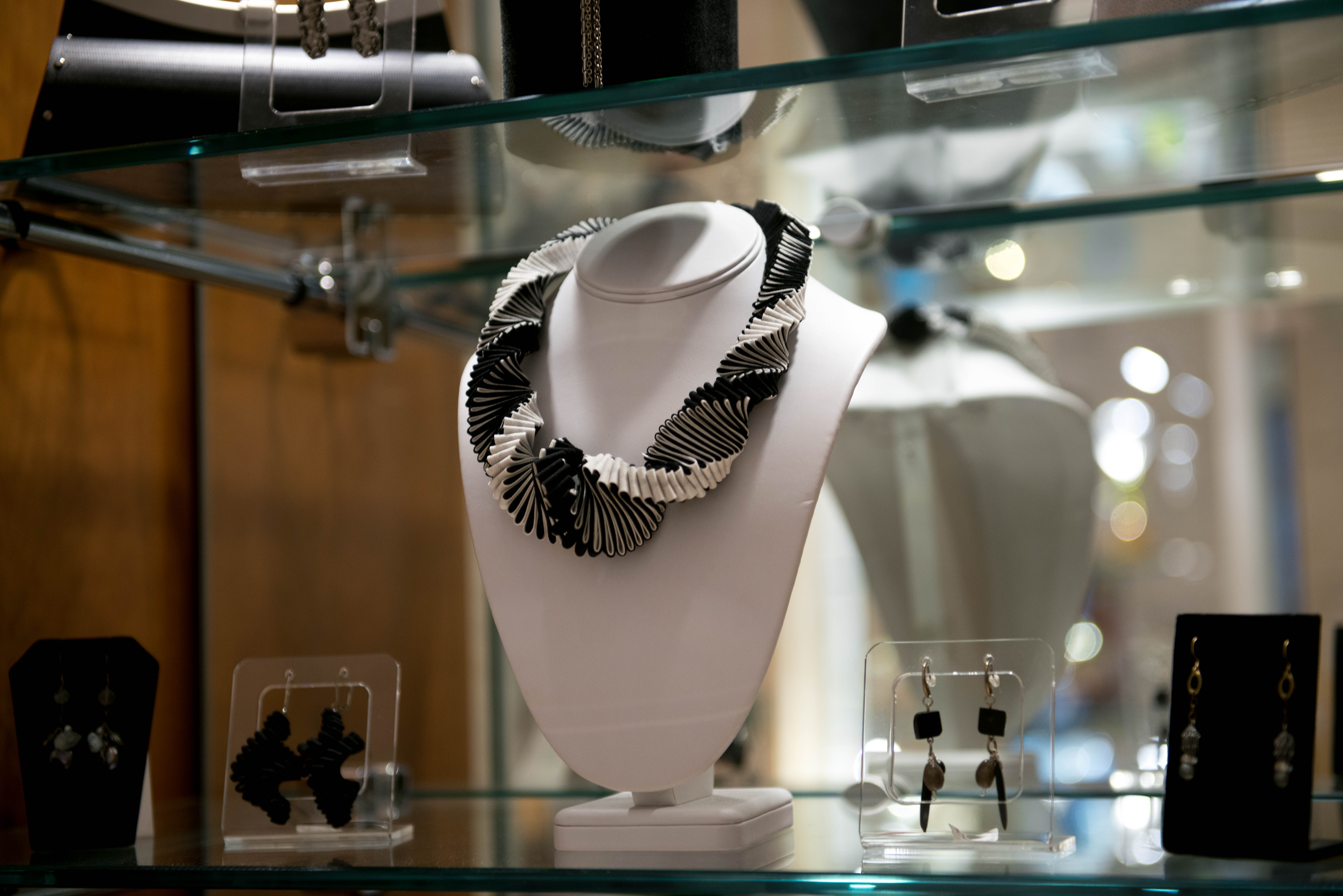 A museum shop display with ladies necklace.