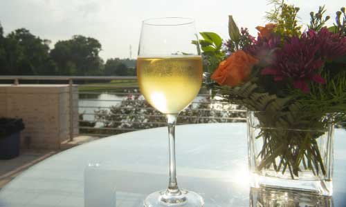 A single wine glass on the Museum Terrace