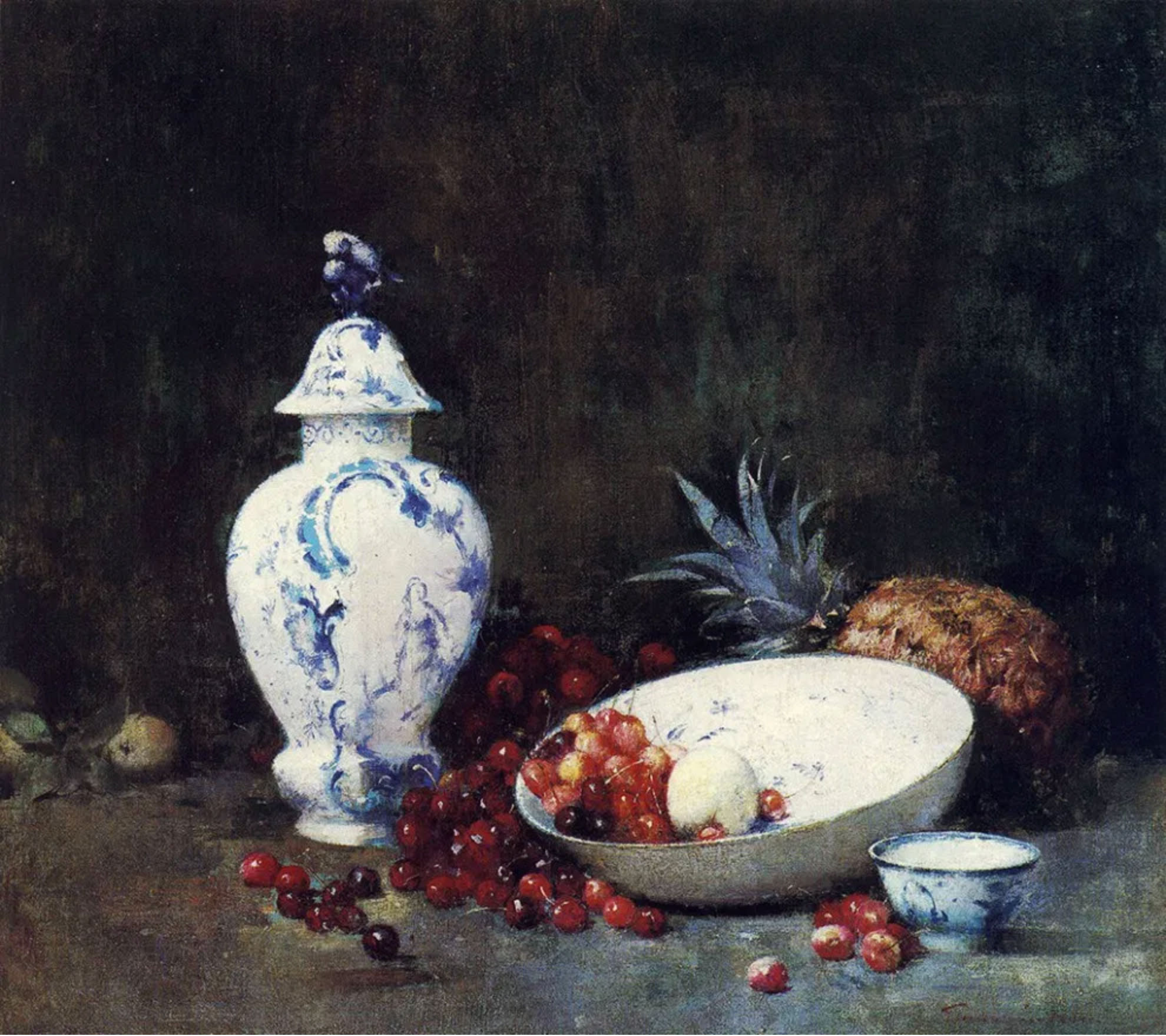 An arrangement of cherries, spilling out of a bowl, with a pineapple propped up against the bowl.