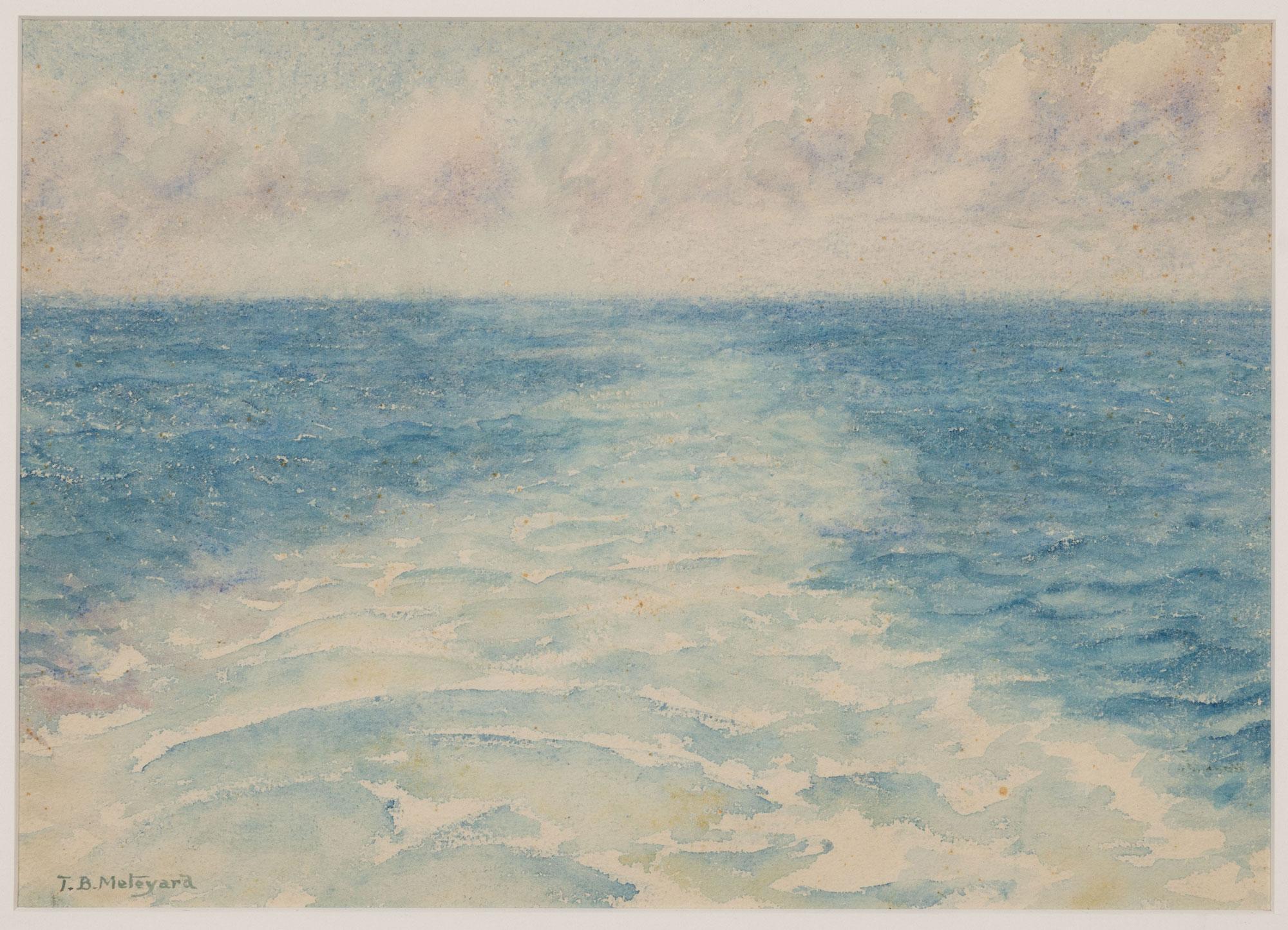 A boat's wake in an empty ocean landscape.