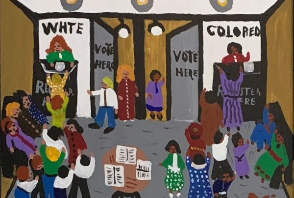 People voting in segregated booths.