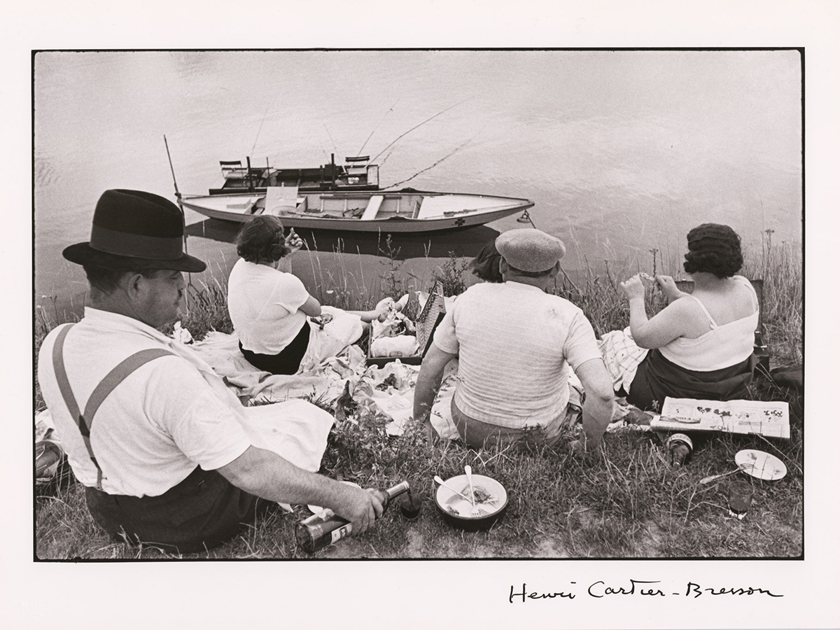 A photograph of couples enjoying a picnic.