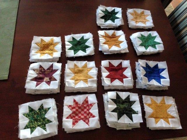 Stacked quilting squares with colorful stars