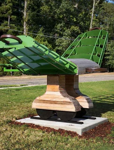 Kurt Dyrhaug (Texas, b. 1966) Large Tractor Wing , 2012 Steel and cypress 1st Place Award
