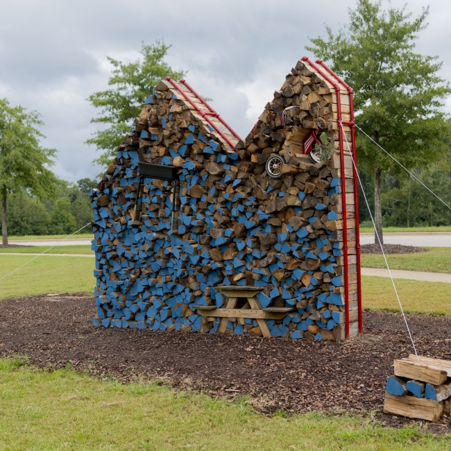 Heath Matysek-Snyder (Virginia, b. 1978), Komíny-NBS Explore, 2013, firewood, picnic table, desk, tricycle, paint, and steel pipe, ca. 108 x 144 x 48 inches