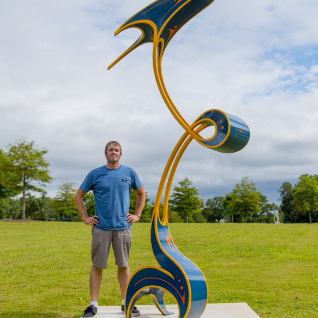 Artist Luke Achterberg shown here with Fettle.