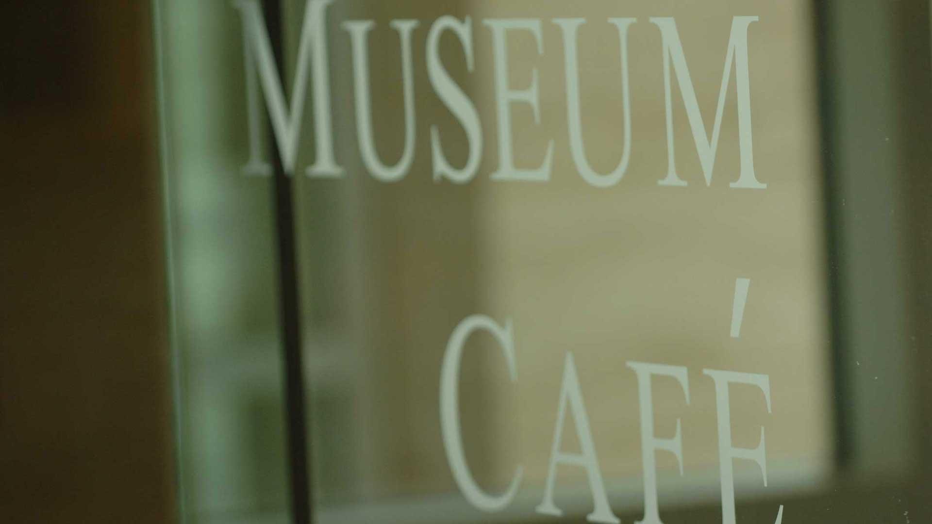Glass door to Museum Cafe