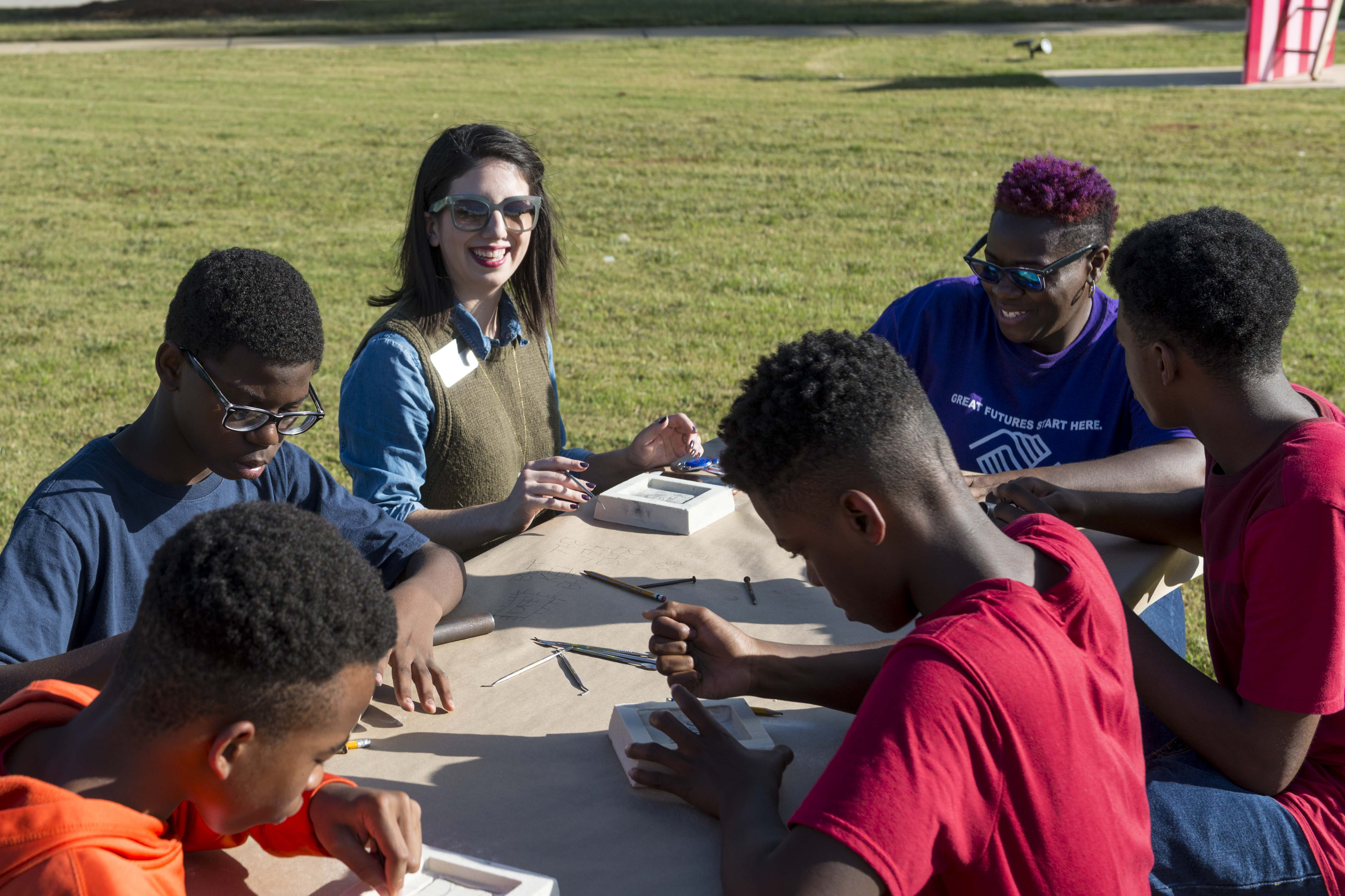 Education curator works with outreach program participants.