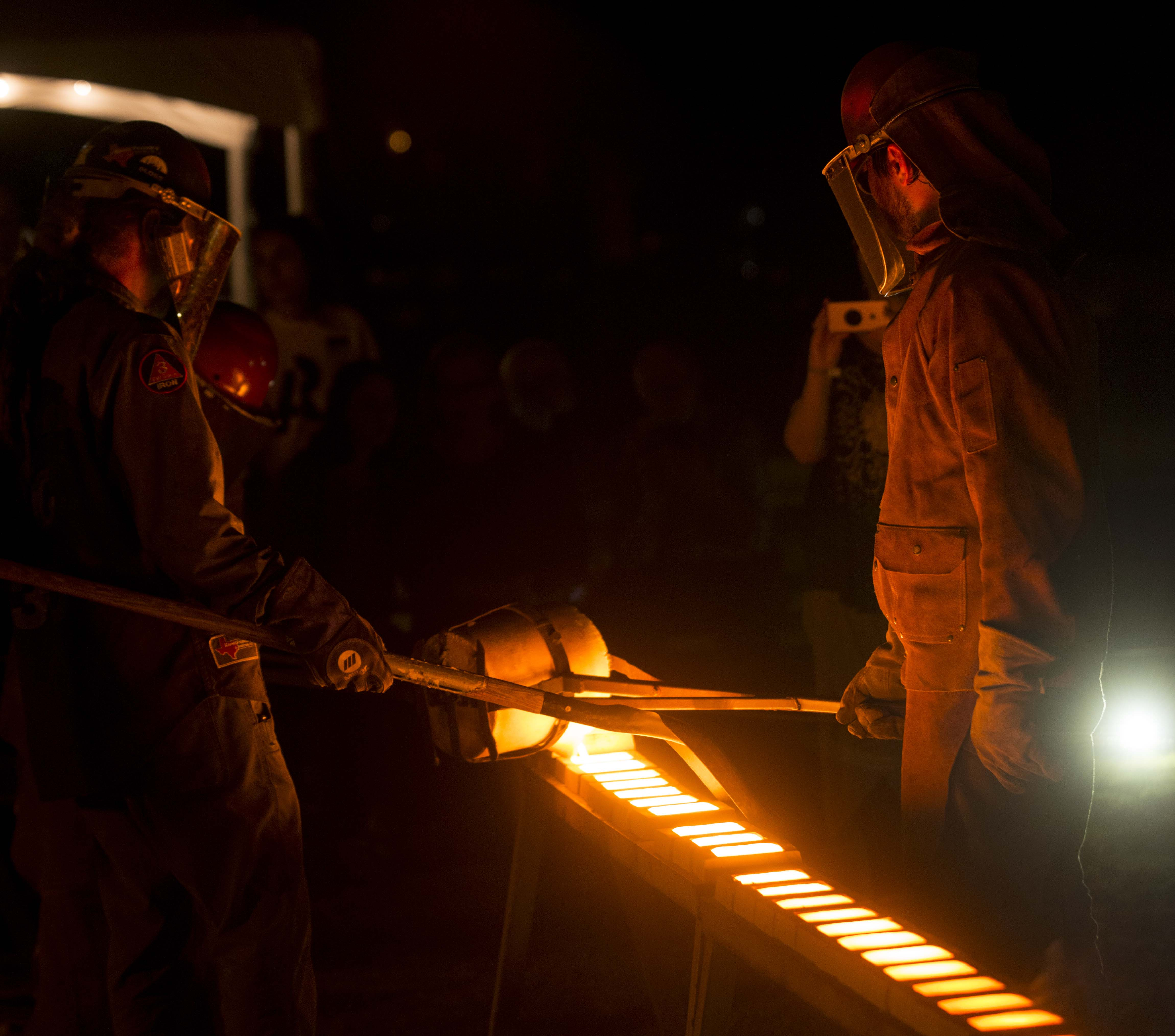 Sloss Metal Artists pour iron into molds