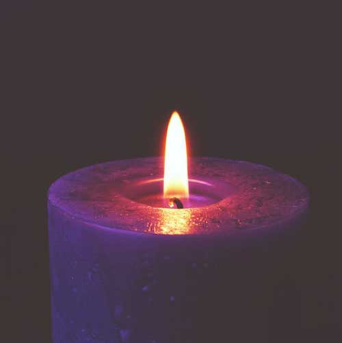 A purple candle with flame.