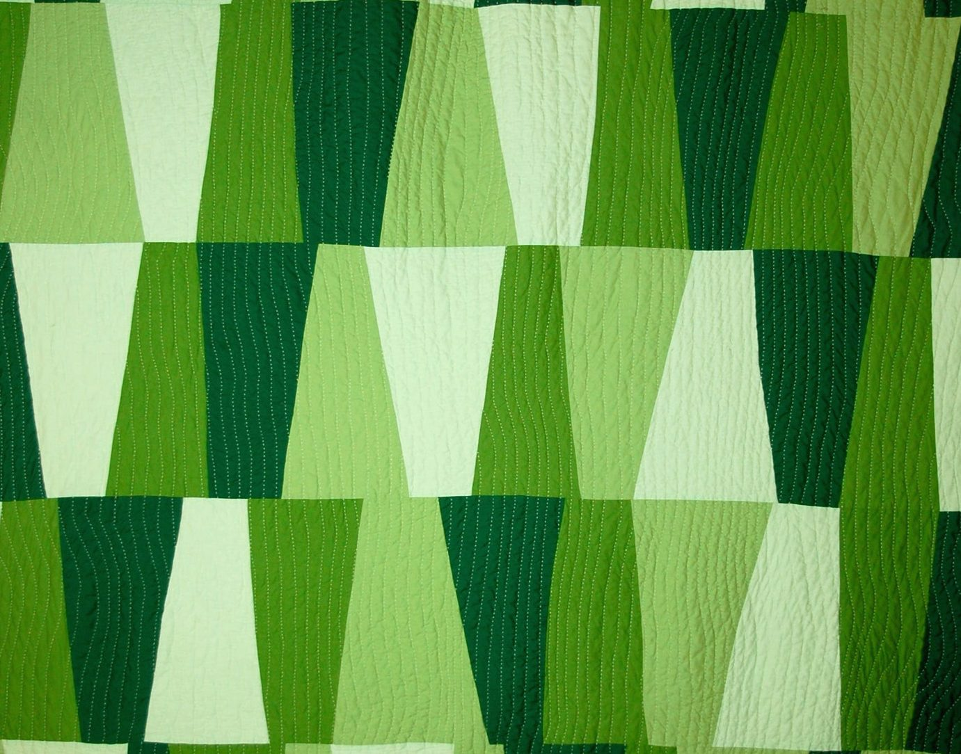 A geometric patterend quilt by Cathy Fussell