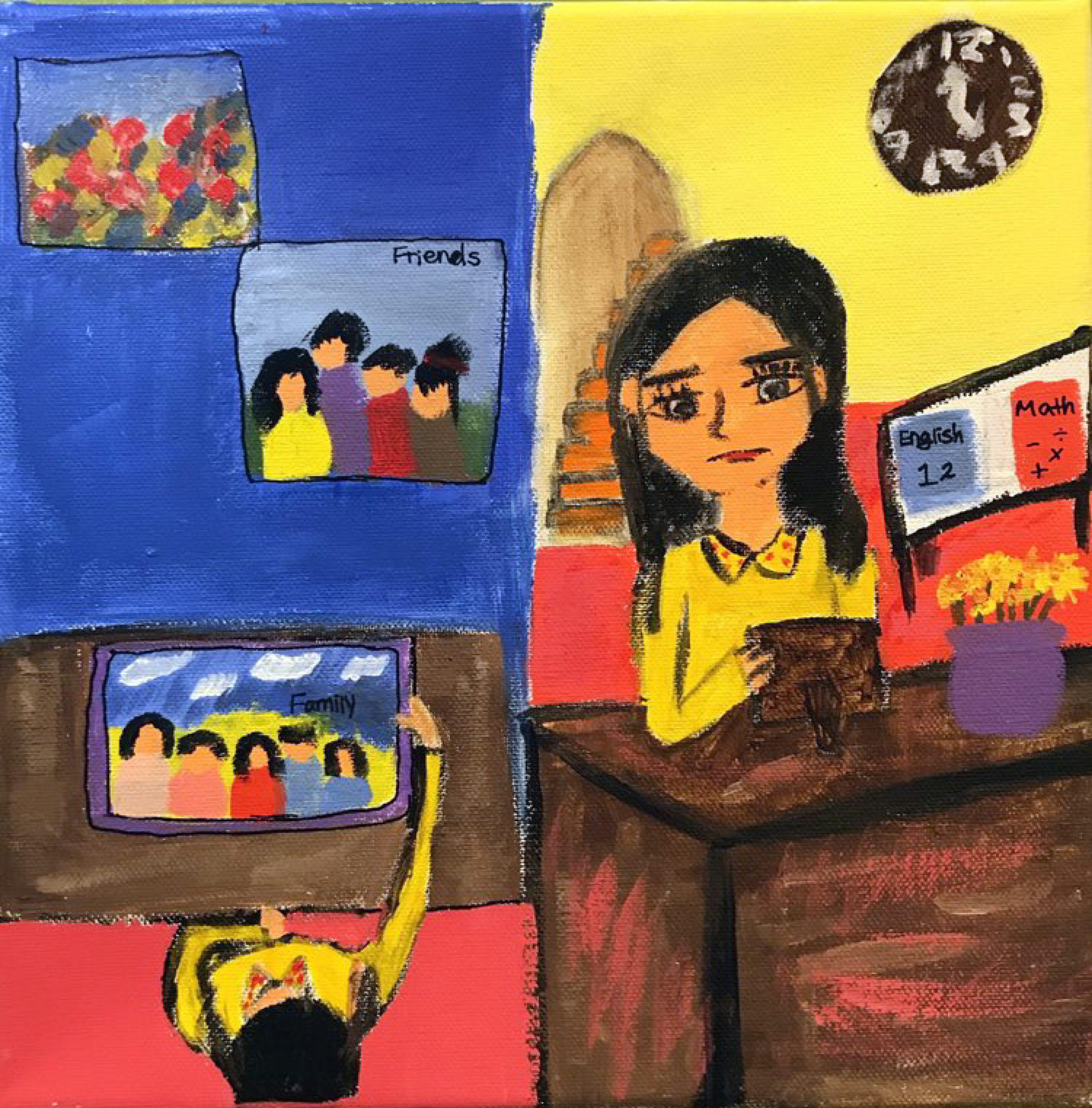 A girl looks at a picture frame with pictures of her family. Pictures of friends hang on the wall. Textbooks show that she is studying.