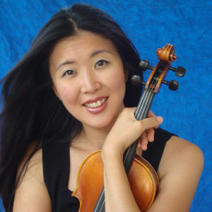 Helen Kim poses with her violin.