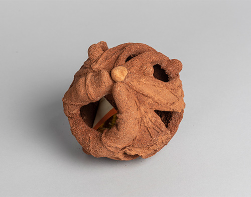 Andy Holliday, Ling Dai, 2018, Sand, soil, and Joss paper money 6 x 6 x 6 inches