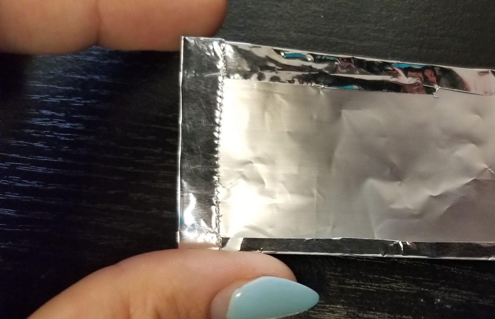 Detail of ends of aluminum foil rectangle.