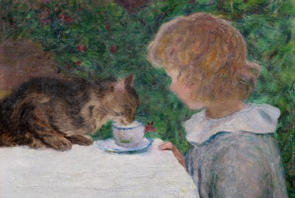A small cat drinks out of a girl's teacup.
