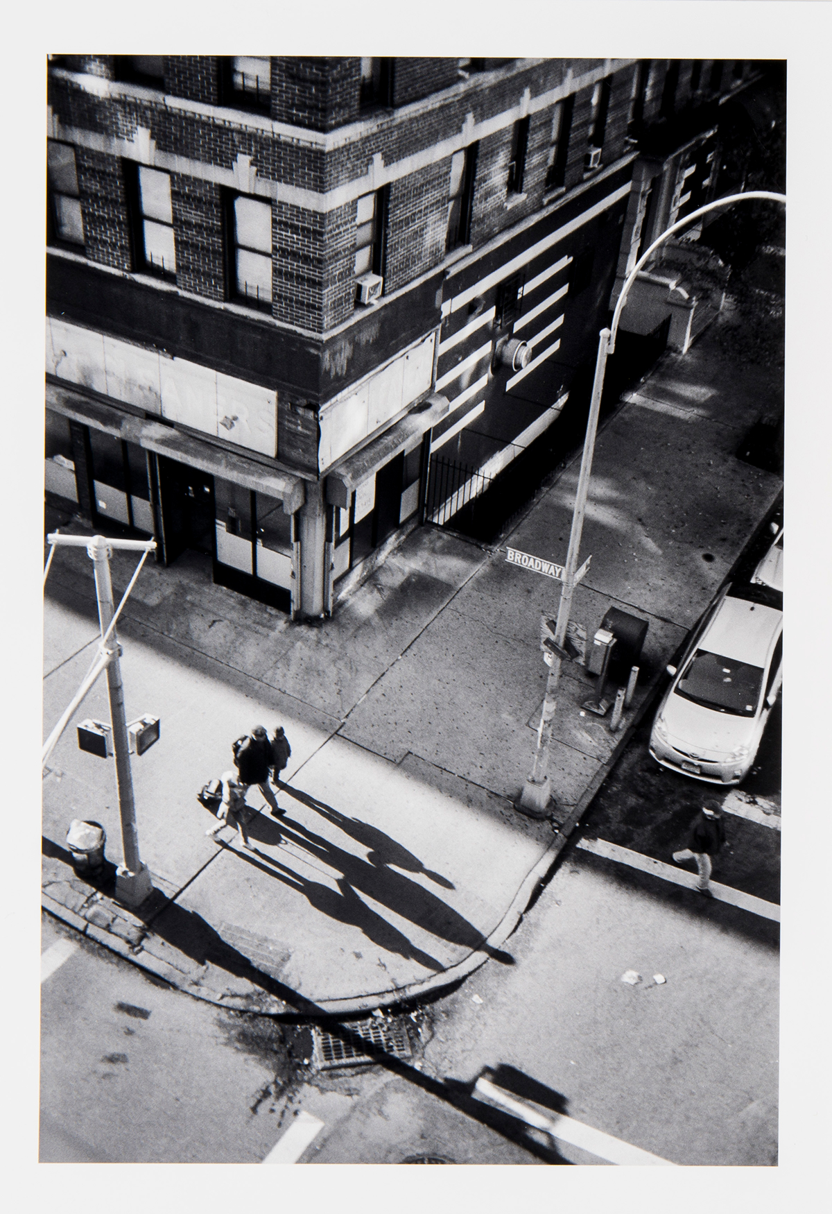 A photograph of passersby on the street from a high vantage