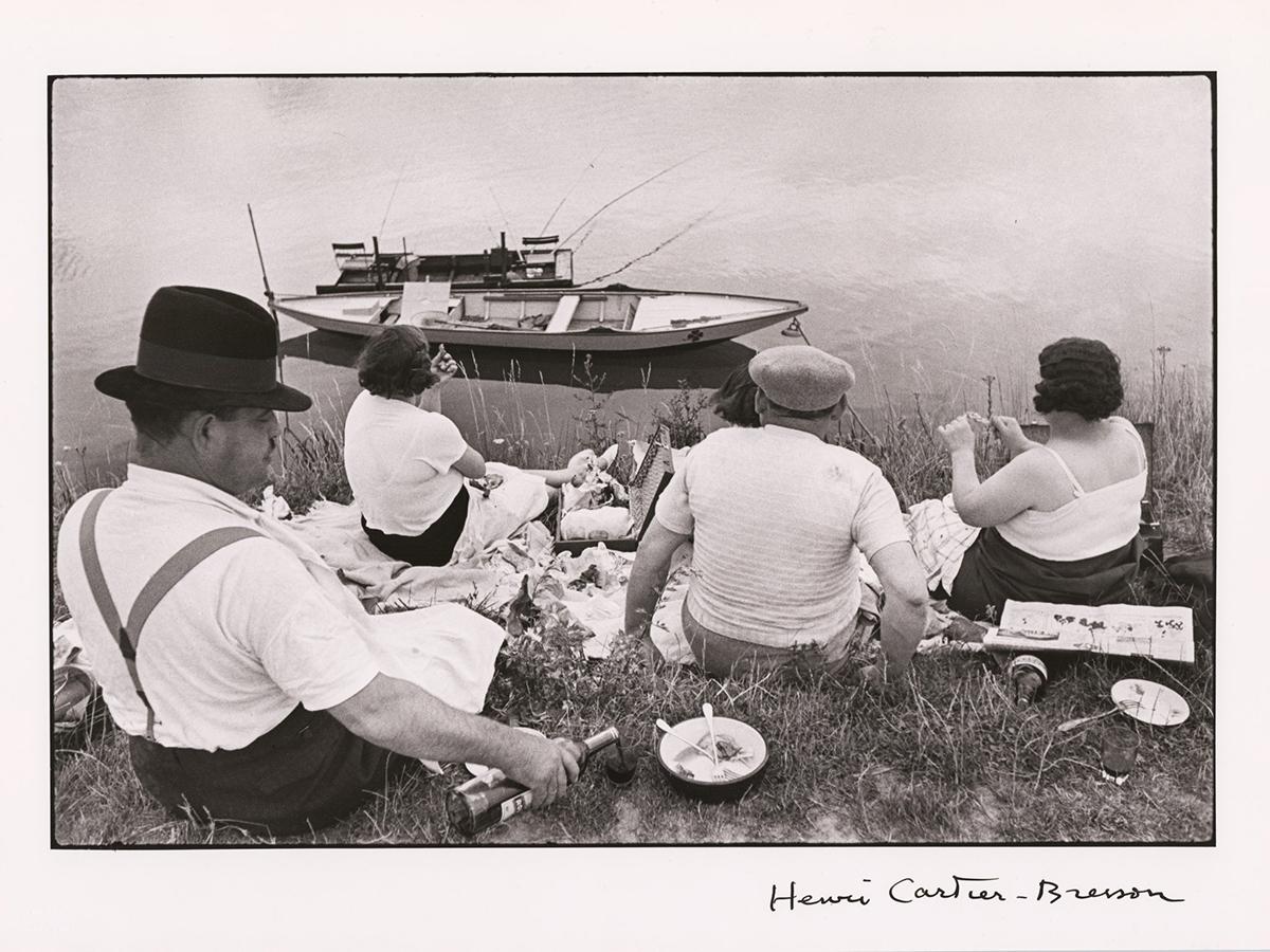 A photograph of couples enjoying a picnic.
