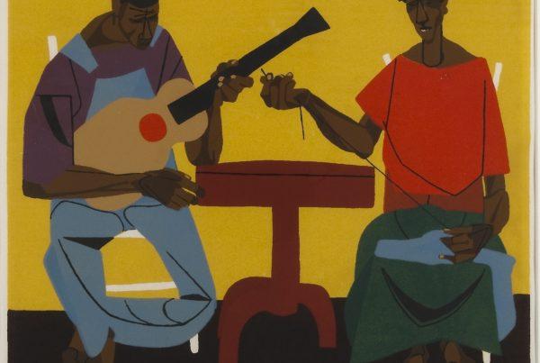 A Black man plays guitar while a Black woman sews.