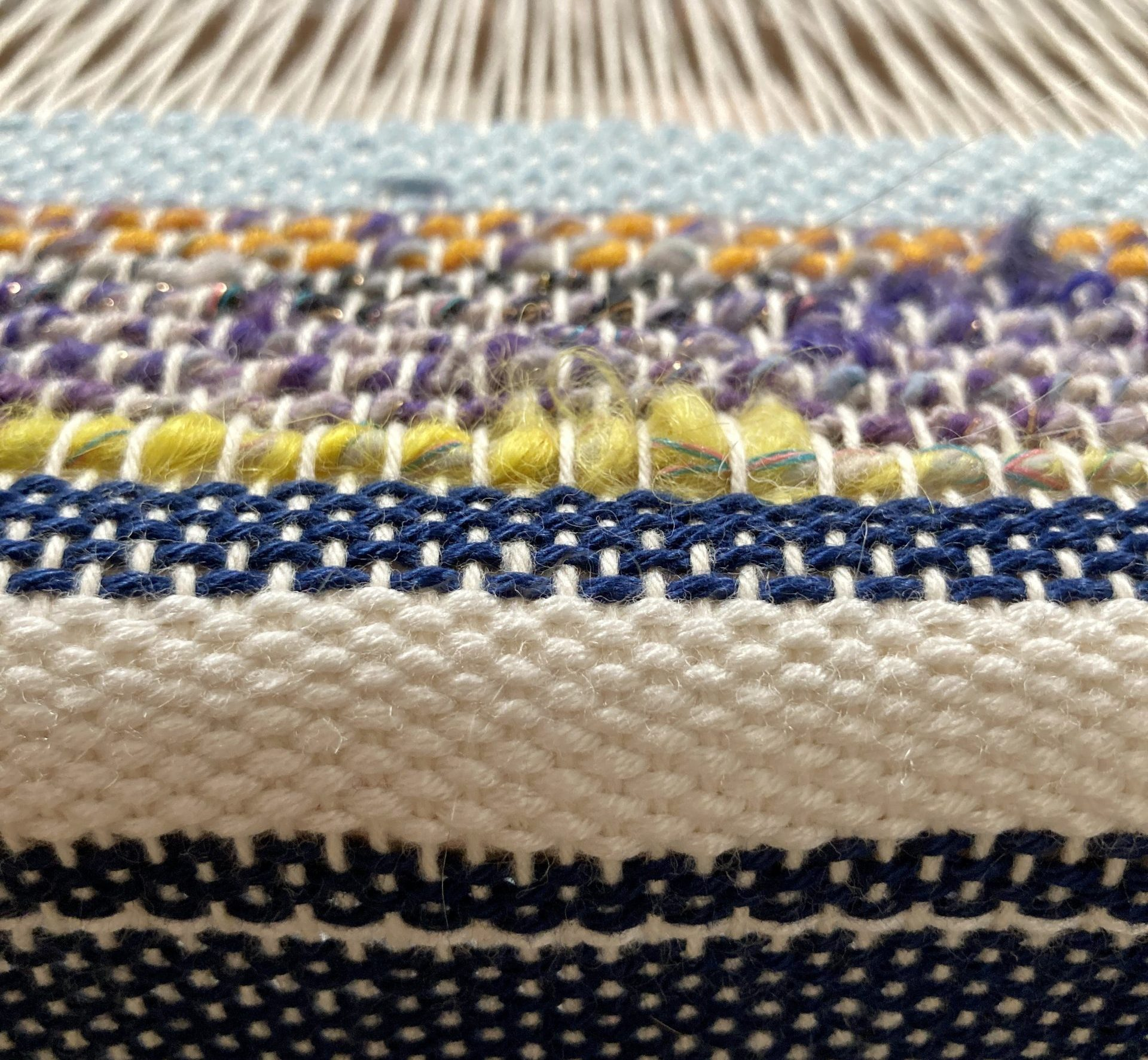 Close up of handwoven cloth on a loom