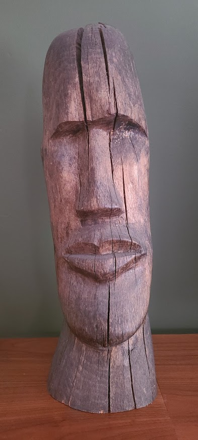 A wooden carving of a head.